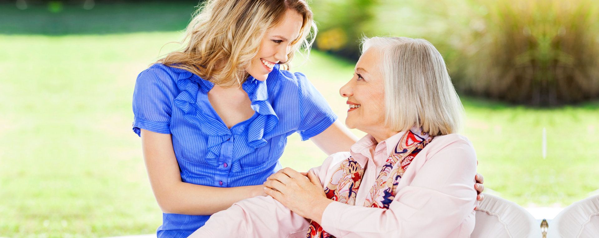 caregiver holding the hands of patient while looking at each other